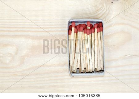 Matchstick In Matchbox On Wooden Background