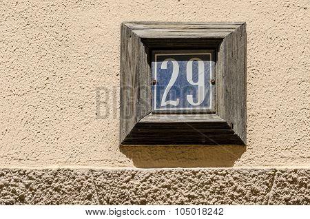 A House Number Twenty Nine (29) On A Wall.