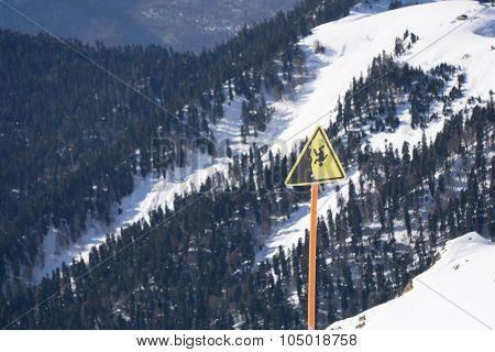 danger steep cliff mountain sign, ski resort