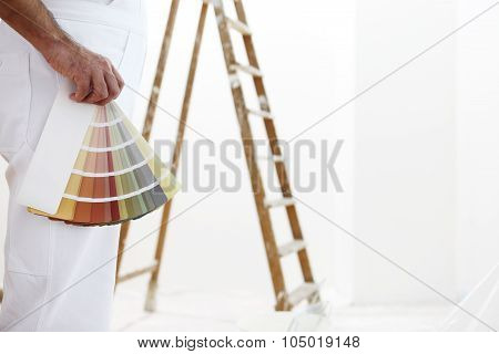 painter man with color swatches in your hand
