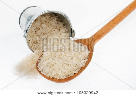 Bucket Of Rice Crumbles In The A Wooden Spoon