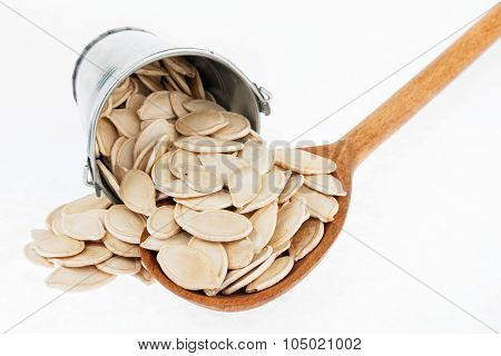 Bucket Of Pumpkin Seeds Crumbles In The A Wooden Spoon