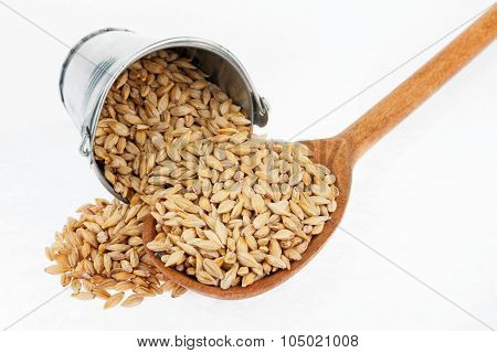 Bucket Of Barley Crumbles In The A Wooden Spoon