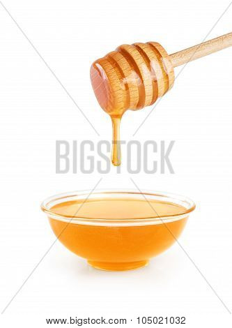 Bowl Of Honey And Wooden Honey Dipper On White Background.