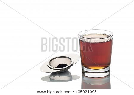 Freshly Brewed Hot Tea In Transparent Glass With Tea Sieve