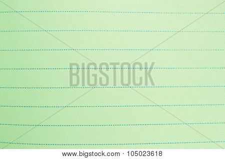 green lined sheet of paper