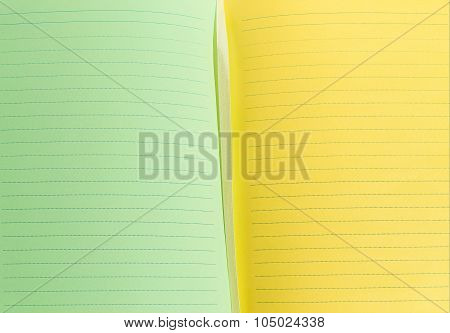 green and yellow sheets of notebook