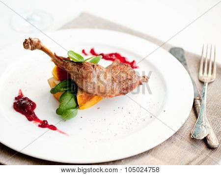 Roasted partridge, chicken thigh with salad
