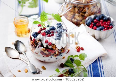 Healthy breakfast. Granola with berries, yogurt