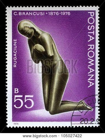 ROMANIA - CIRCA 1976: a stamp printed in Romania shows sculpture of Prayer by Constantin Brancusi (1876-1957), sculptor, circa 1976.