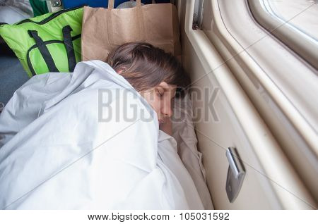 Young Girl Asleep In A Second-class Train Carriage