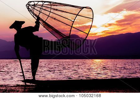 Silhouette of fisherman at sunset Inle Lake