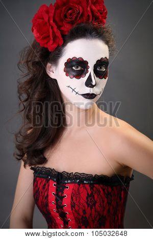 Beautiful girl with sugar skull makeup