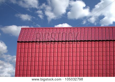 Roof of a country house covered with metal