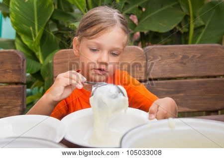 The Girl Lays On Breakfast Porridge