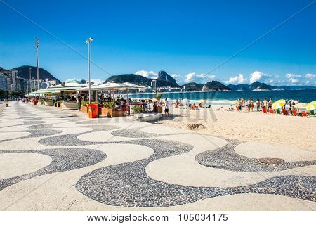 RIO DE JANEIRO, BRAZIL - APRIL 24, 2015: Iconic sidewalk tile pattern at Copacabana Beach on April 24, 2015 in Rio de Janeiro. Brazil.