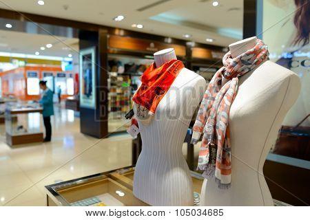 DUBAI, UAE - APRIL 18, 2014: mannequins in the store in Dubai Airport. Dubai International Airport is the primary airport serving Dubai.