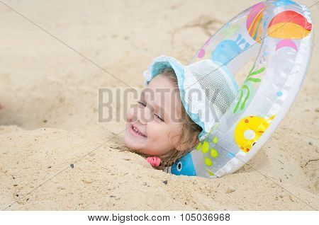 The Girl Was Buried In The Sand On The Beach And Put It Under His Head Round