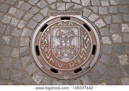 LJUBLJANA, SLOVENIA - JUNE 30: Hatch cover with the coat of arms of Ljubljana, Slovenia on June 30, 2015