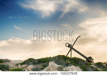 Beautiful anchor in Paros island against a dramatic sky.