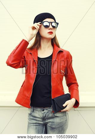 Fashion Portrait Pretty Woman With Red Lipstick Wearing A Rock Leather Jacket, Sunglasses With Handb