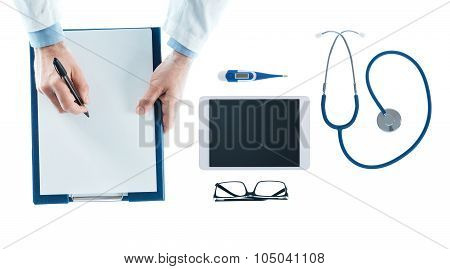 Doctor Writing A Prescription On A Clipboard