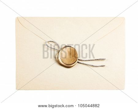 old mail envelope with gold wax seal stamps isolated on white