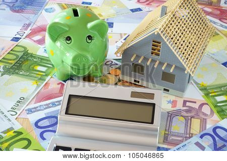 Piggy Bank And Pocket Calculator On Banknotes