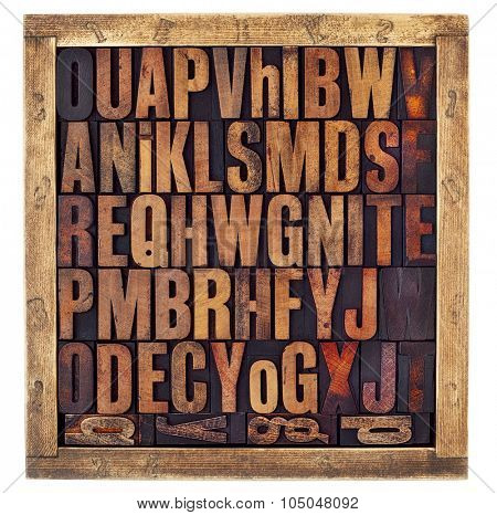 random letters of alphabet - vintage letterpress wood type printing blocks in a rustic box isolated on white