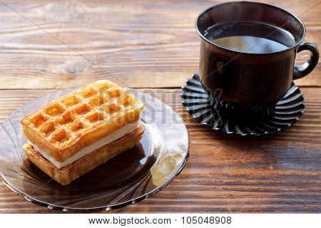 Cup Of Tea And Viennese Waffles