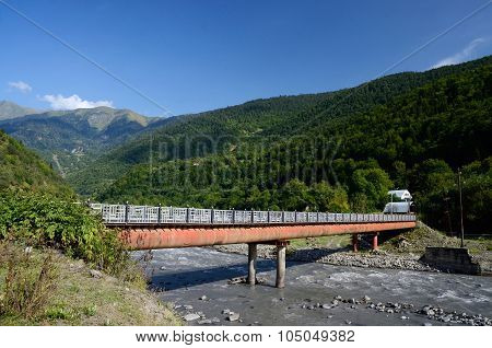 Small Bridge Over Mountain River In Upper Svaneti, Georgia,transcaucasia