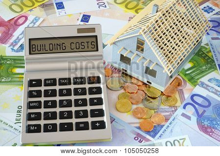 The Words Building Costs On Calculator Display