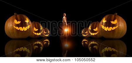 Beautiful Witch With The Magic Lantern. Halloween Pumpkins On The Foreground.