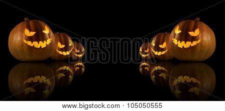 Halloween Pumpkins On The Dark Background.