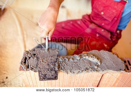 Construction Mason Worker Bricklayer Installing Brick Walls With Trowel Putty Knife