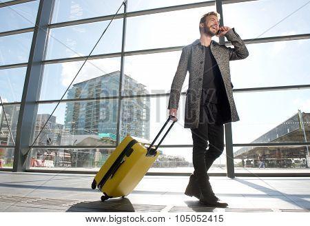 Smiling Travel Man Walking And Talking On Mobile Phone
