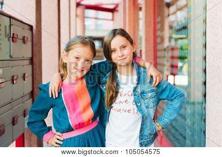 Outdoor portrait of adorable little girls