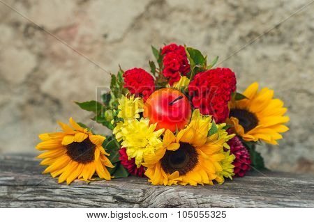 Autumn bouquet of sunflowers and red cockscombs