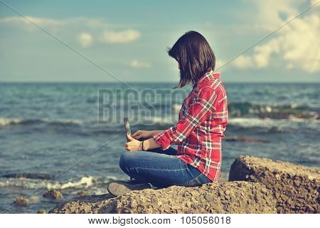 Girl With Notebook Sitting On Rock