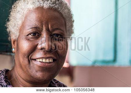 Brazilian woman smiling inside a house