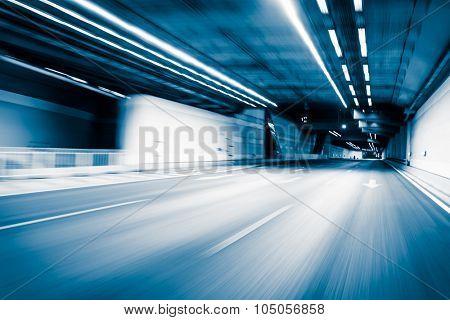 Blue color tunnel car driving motion blur