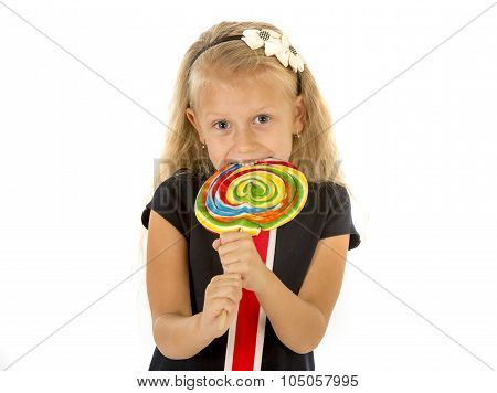 Beautiful Female Child With Long Blond Hair Eating Licking Huge Spiral Lollipop Candy Smiling Happy