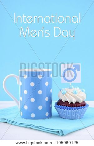 International Mens Day Cupcakes With Male Symbols.