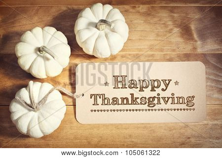 Happy Thanksgiving Message With Small White Pumpkins
