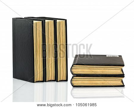 Closed Black Book With Shadow On White Background