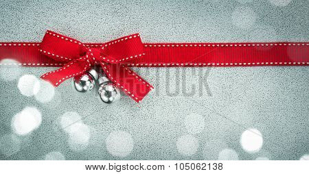 Red ribbon bow with bokeh,Paper textured background.
