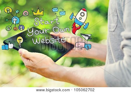 Start Your Own Website Concept With Young Man Holding His Tablet Computer