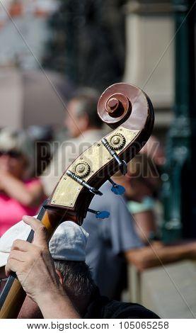 Musician playing cello on Charles bridge