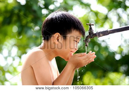 Boy Wait For Water From Tap