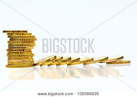 stacked and lying coins symbolfoto for debt, profit collapse and deductions